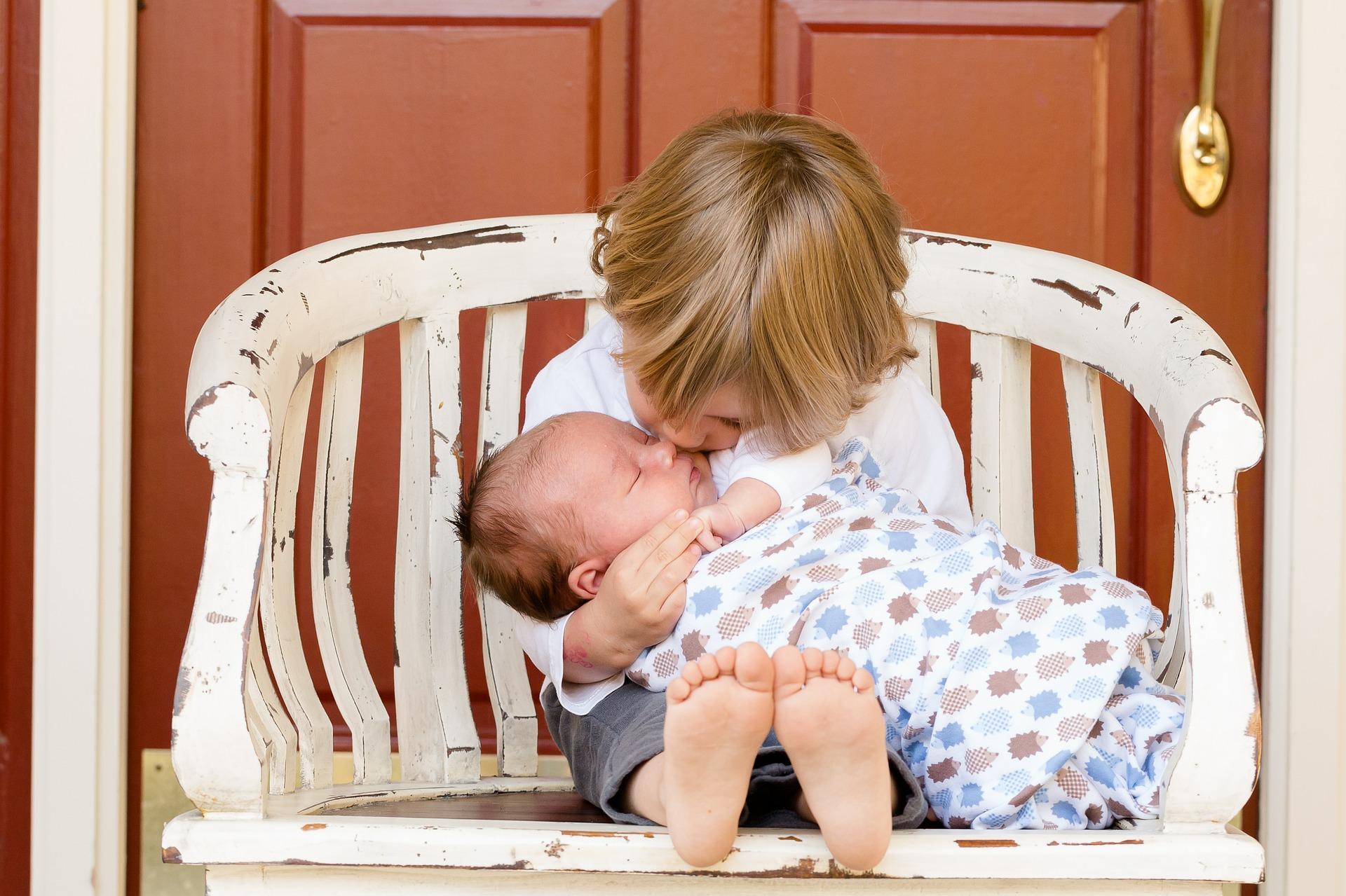 Siblings Sitting in Chair (Family)