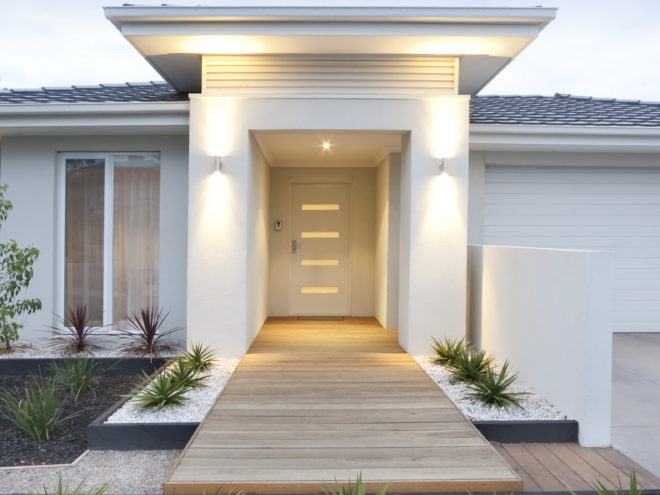 Facade and entry to a contemporary white rendered home in Australia - vertical