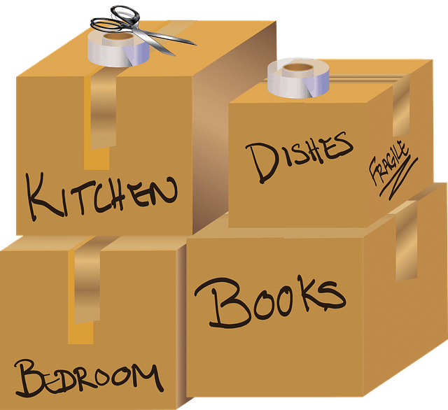 moving boxes with tape and scissors