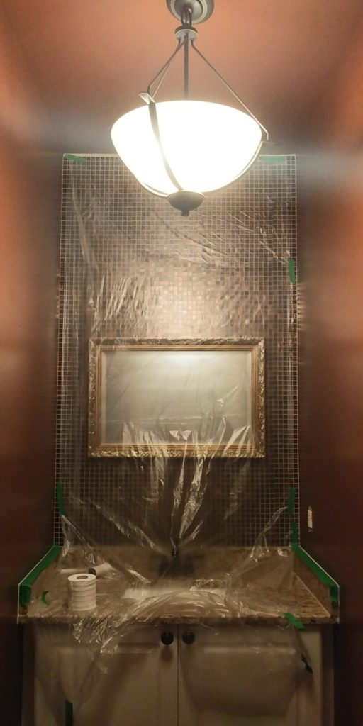Rich brown powder room - painting in progress