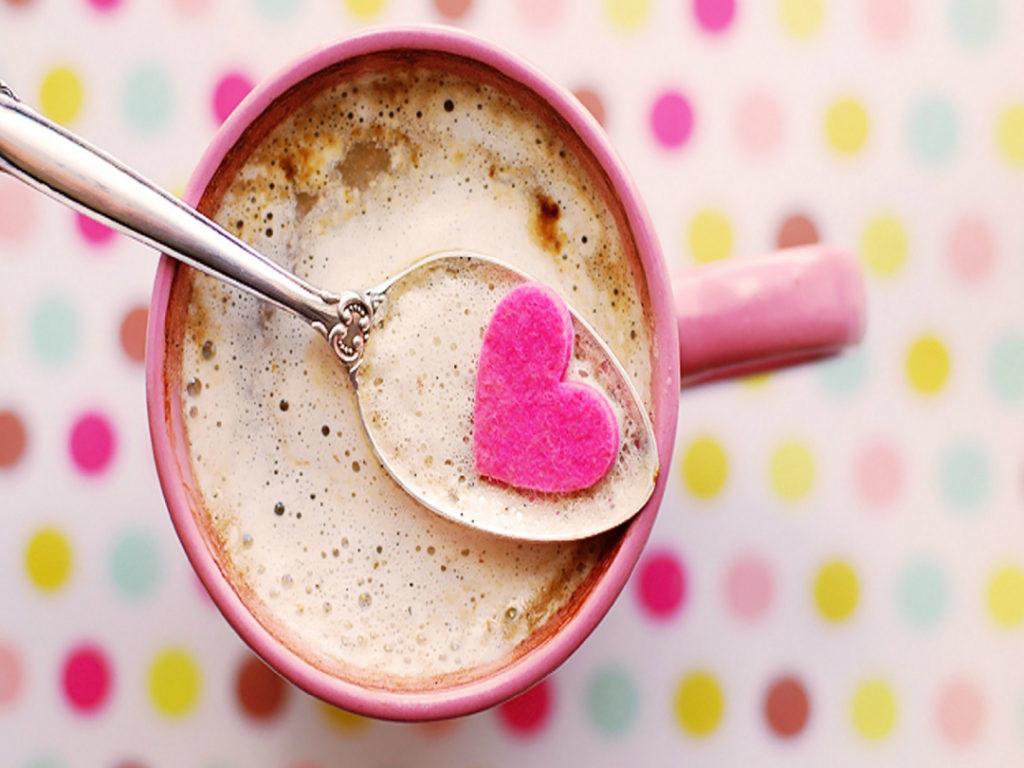 creamy coffee in pink mug