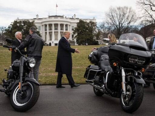 Vice President Mike Pence and President Donald Trump greet Harley-Davidson executives at the White House in February 2017.