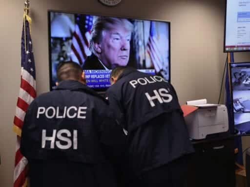 Agents with ICE's Homeland Security Investigations work with police in March to arrest gang members in New York.