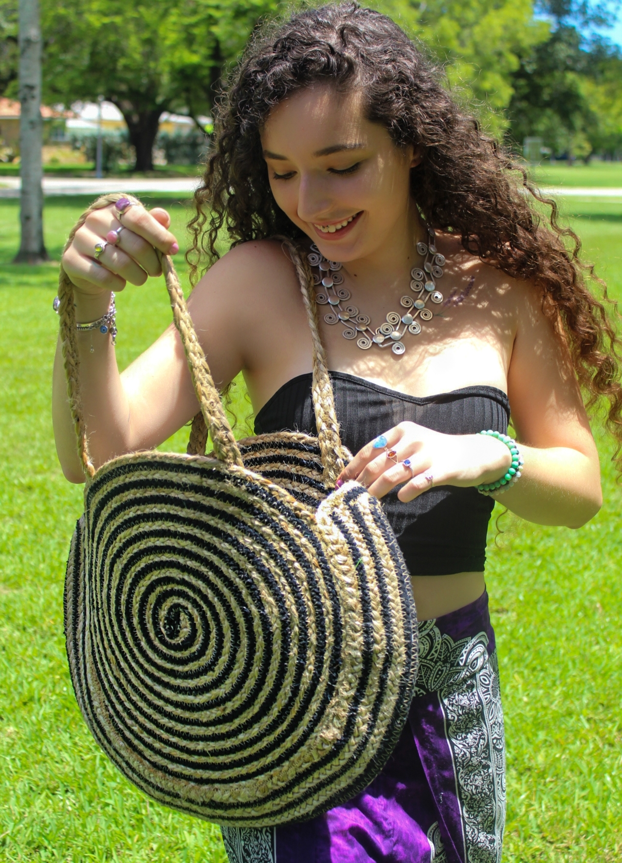 Model Wearing Hand Woven Handle Bag and Silver Jewelry