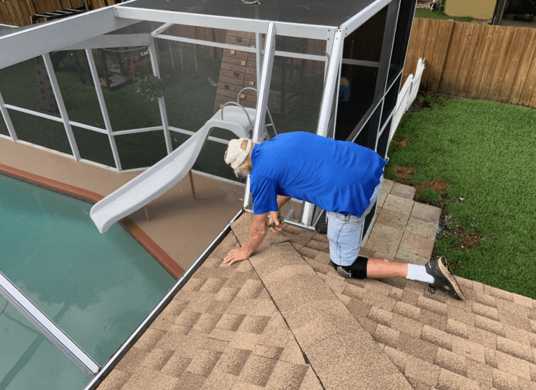 Tampa Roofer repairing a Shingle Roof Leak.