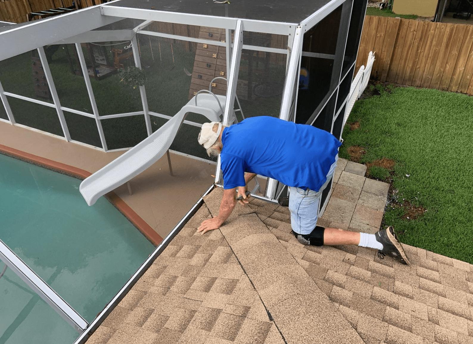 Tampa Roofer repairing a Shingle Roof Leak.