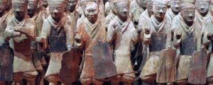 Clay statutes of Chinese martial artists and soldiers in various postures.