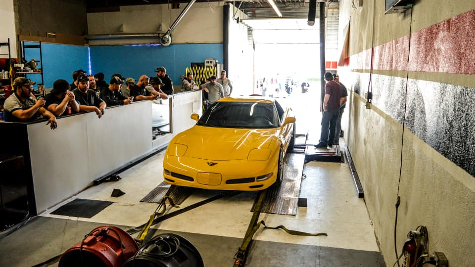 Yellow Corvette on chassis dyno at international dyno authority's 2017 Dyno Day