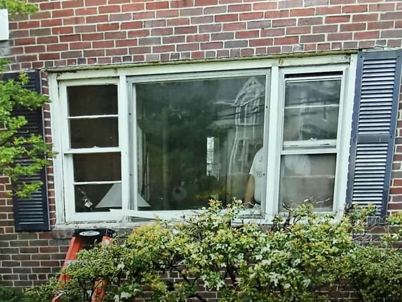 Before-New bay window replacing double hung and picture window