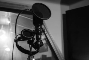 Recording in the Recording Booth with Neumann Recording Microphone and Sennheiser Headphones