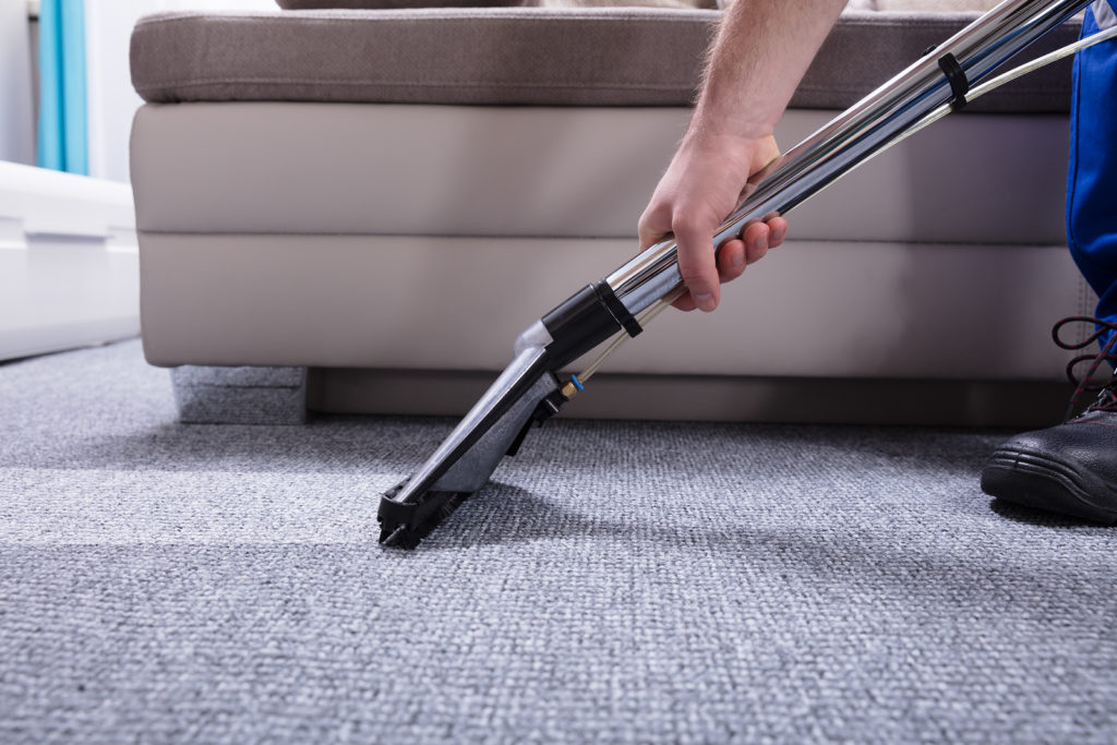 bigstock-Janitor-Cleaning-Carpet-235838623-1024x683