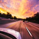 how to avoid hydroplaning sunset driving at night image