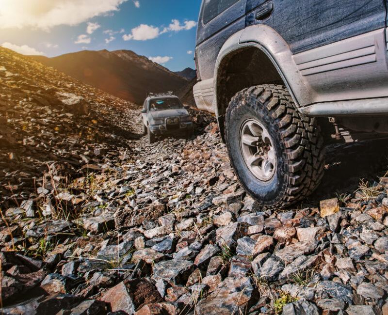 Jeeps on rocky road