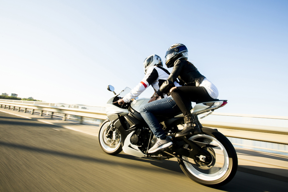 two people on a motorcycle