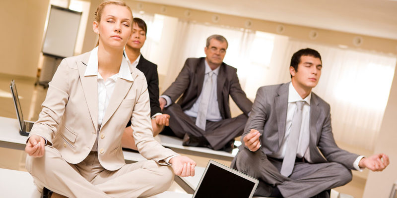 People doing yoga on their desks