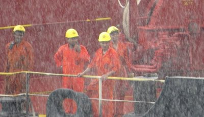 Workmen in heavy rain