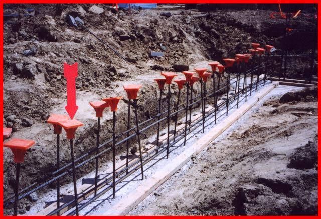 Plastic covers placed on free-standing rebar to prevent impailment