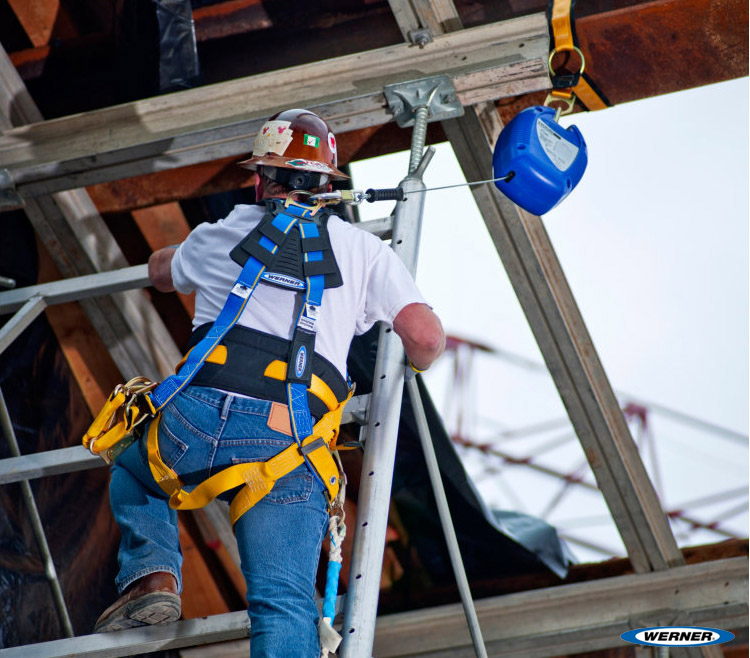 Man working with proper fall arrest equipment