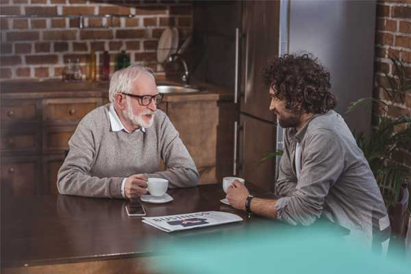 Sober Living Homes - Two men talking over coffee