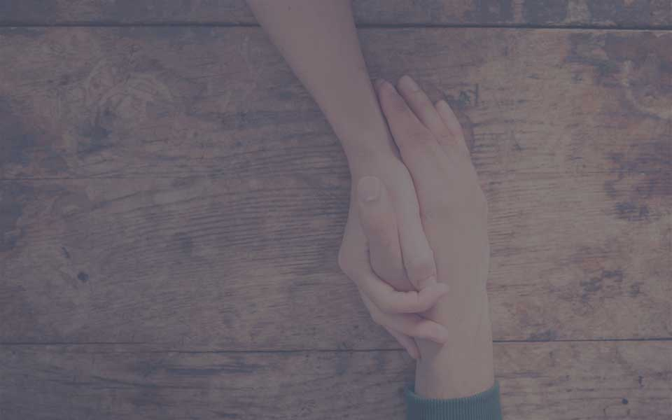 Long-Term Living Homes - Hands holding each other