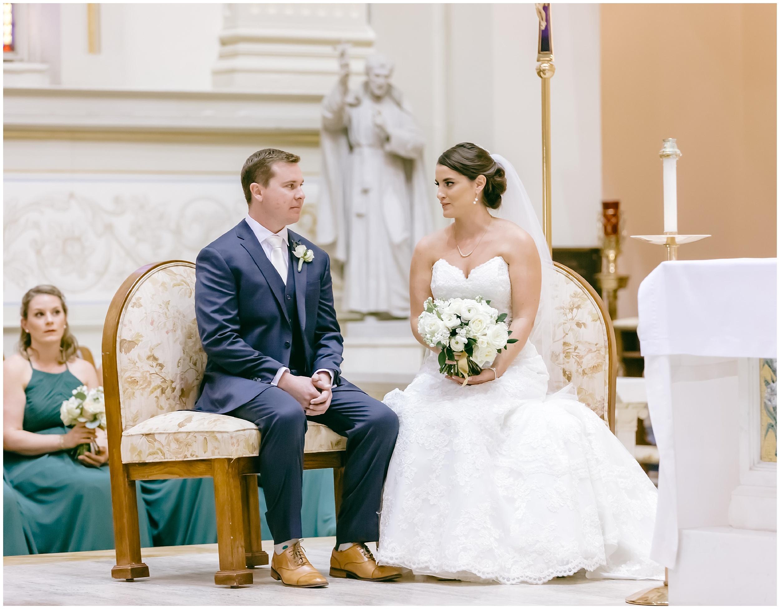 wedding-ceremony-bride-groom-seated-catholic-washington-dc-photographer