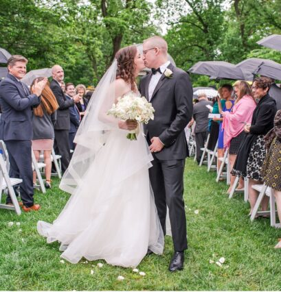rain-wedding-outside-just-married-kiss