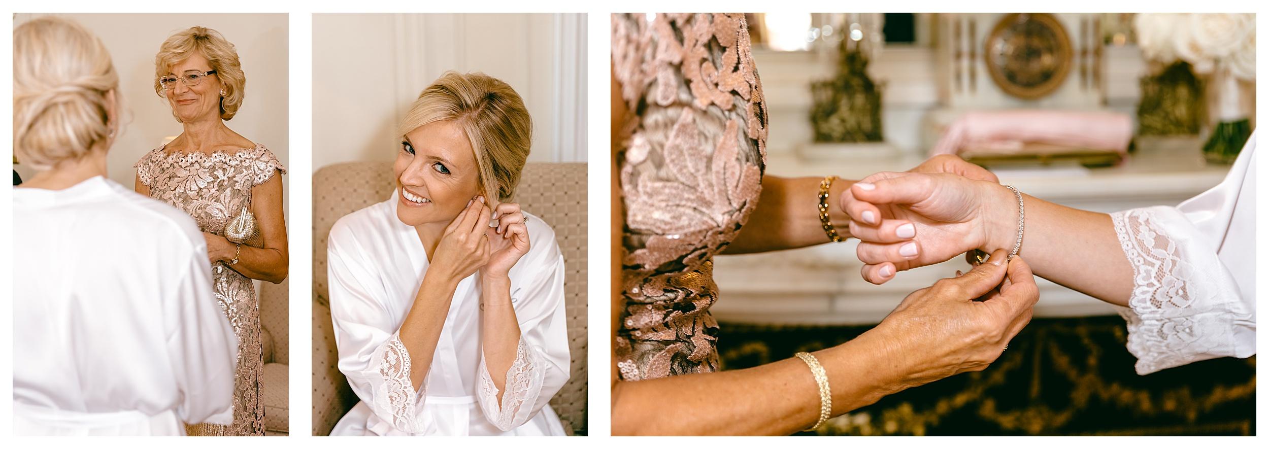 bride puts on earrings and bracelet