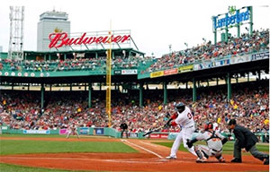 an image of David Ortiz of the Boston Red Sox batting from home plate at Fenway Park.