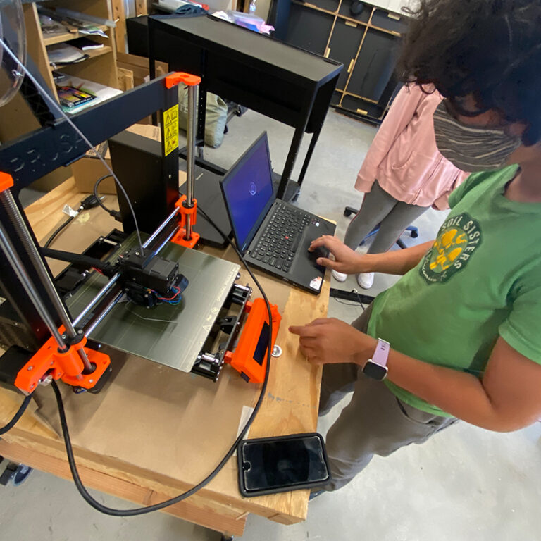 Student using a 3-D printer.