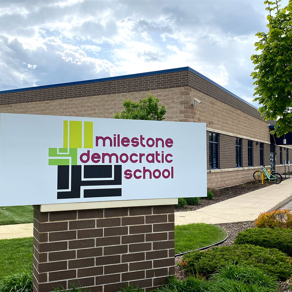 Milestone Democratic school building on a sunny day