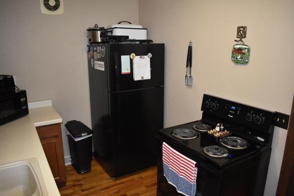 Kitchen refrigerator and stove at FishInn