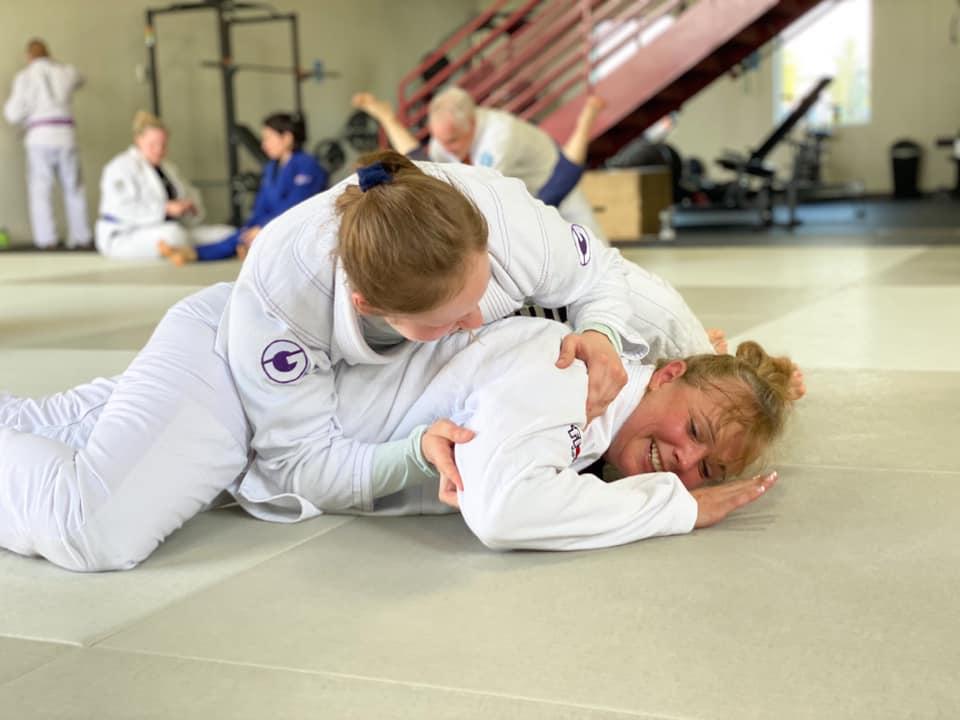 Two women training jiu-jitsu at prodigy martial arts in blaine mn