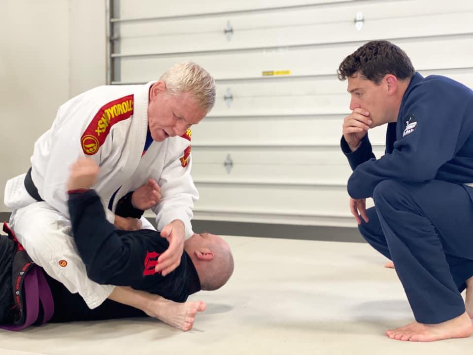 Black Belt in BJJ Showing A Shoulder LockSubmission