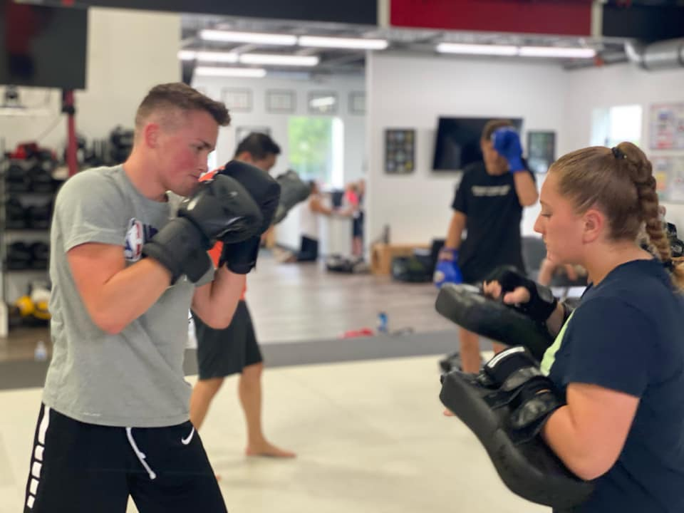 Boy and girl holding Muay Thai Pads
