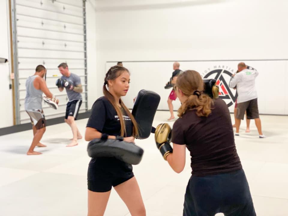 Two Women doing Muay Thai Kickboxing in Blaine MN