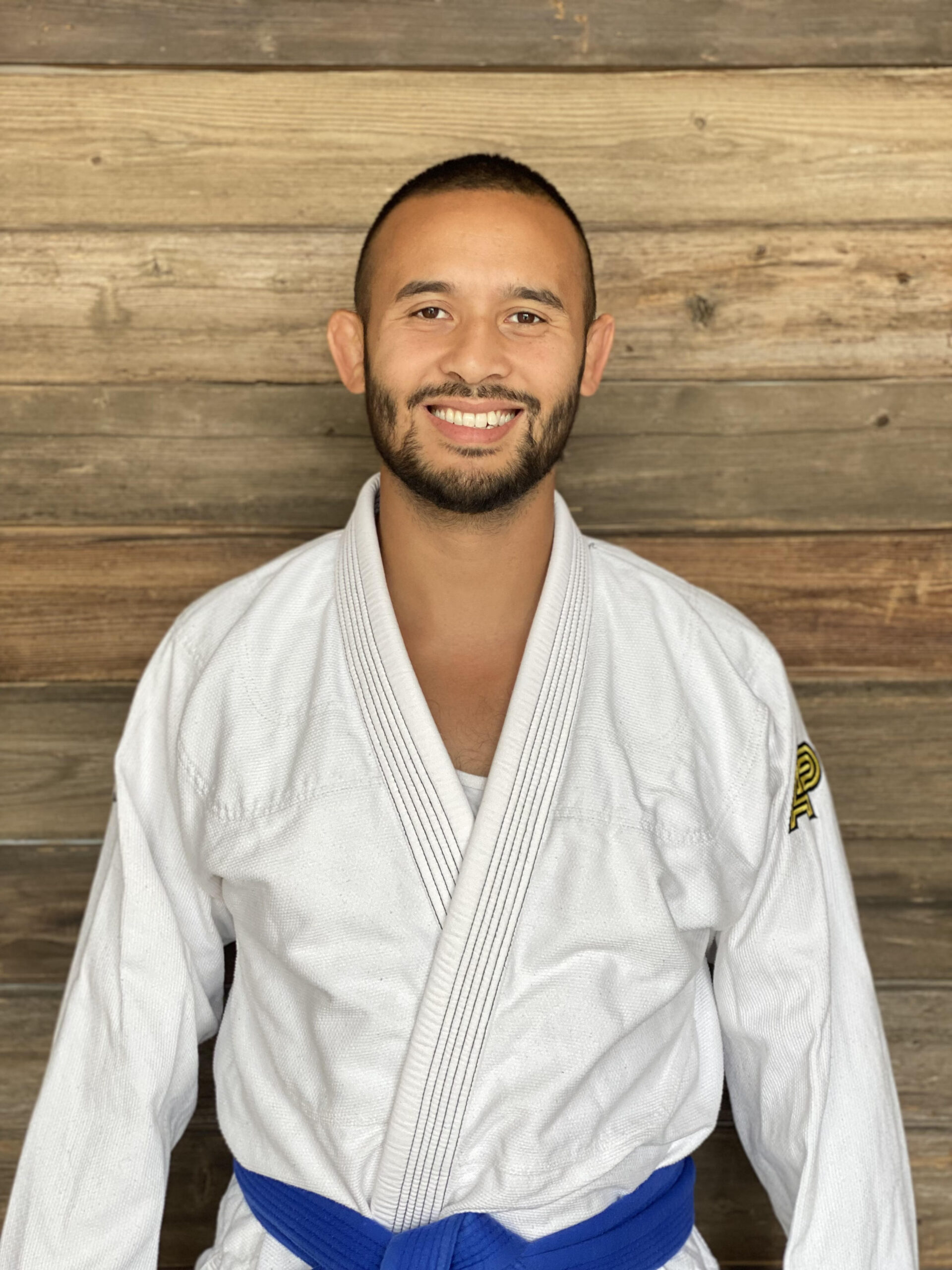 Coach Bill posing in a white Jiu-Jitsu Gi at Prodigy Martial Arts in Blaine, MN