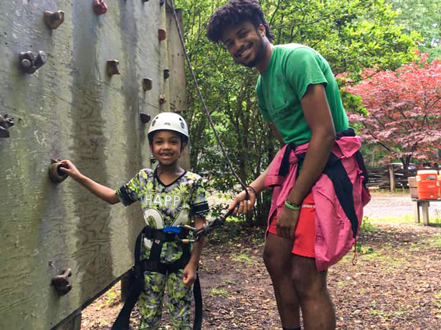 Ready to climb the rock wall