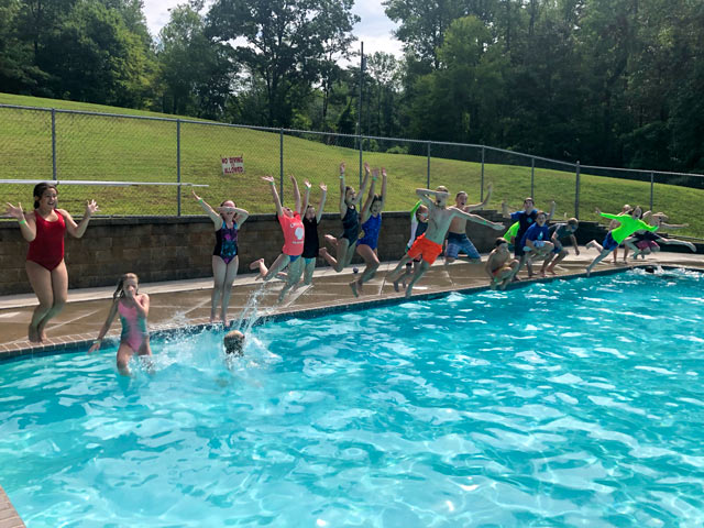 Group jumping into the pool