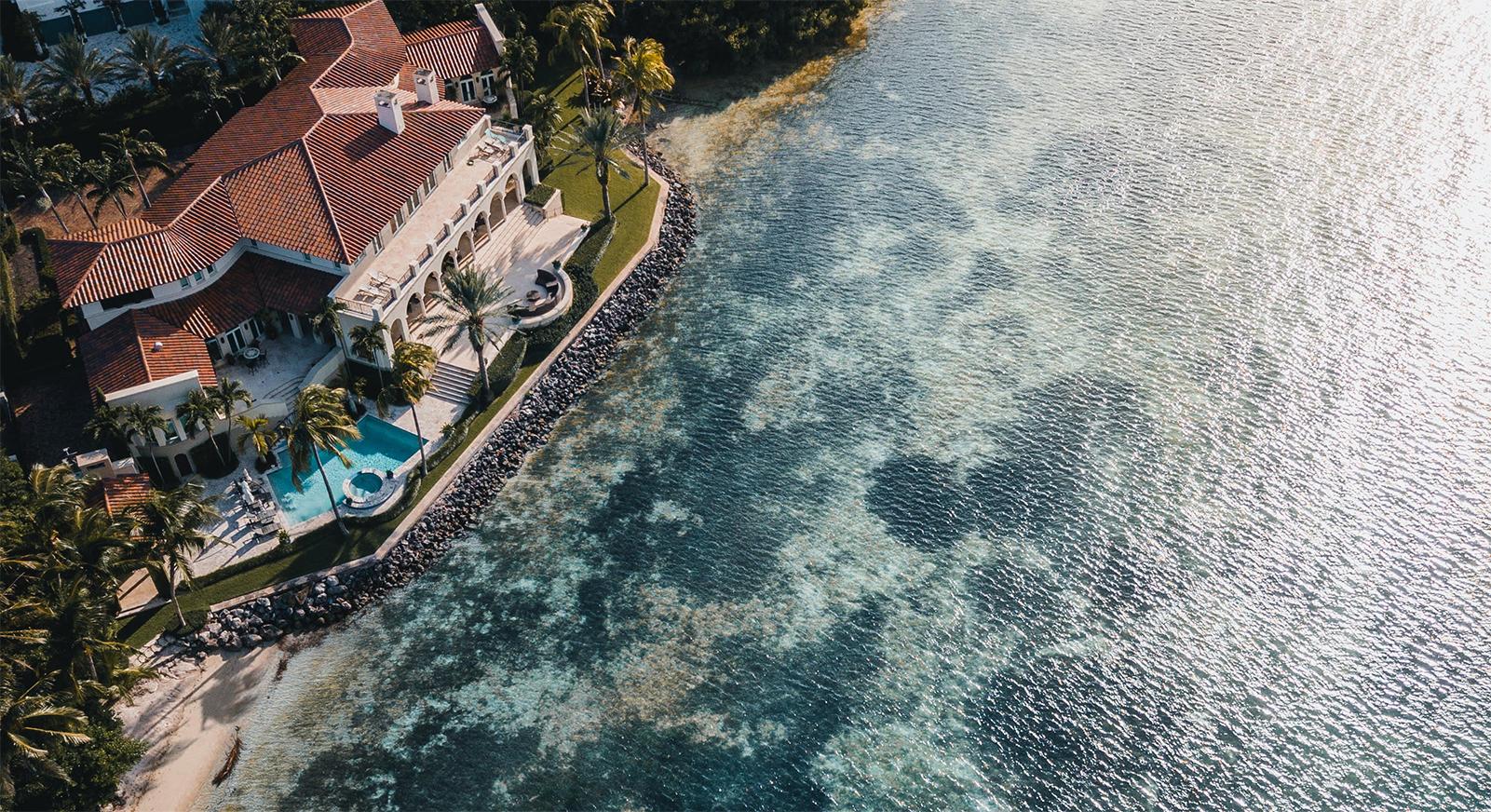 luxury home sits on florida ocean shoreline