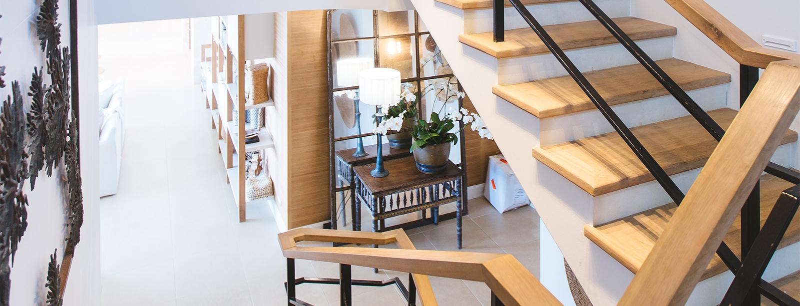 multi level wood stairway in luxury home