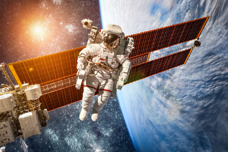 International Space Station and astronaut in outer space over planet Earth provided by NASA