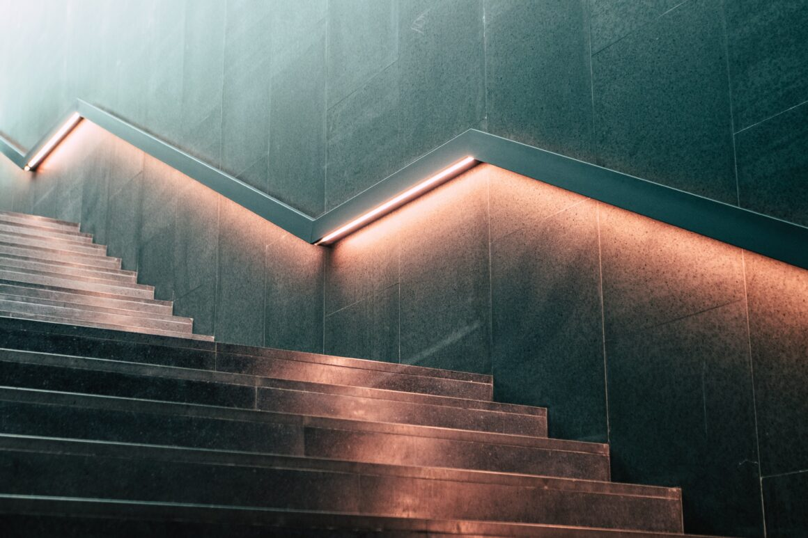 Stairway with lighting underneath the railing