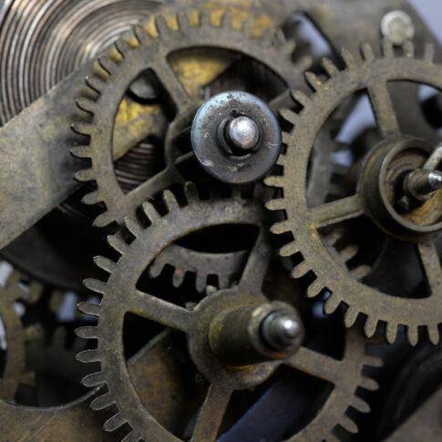 gears of clock movement in brass