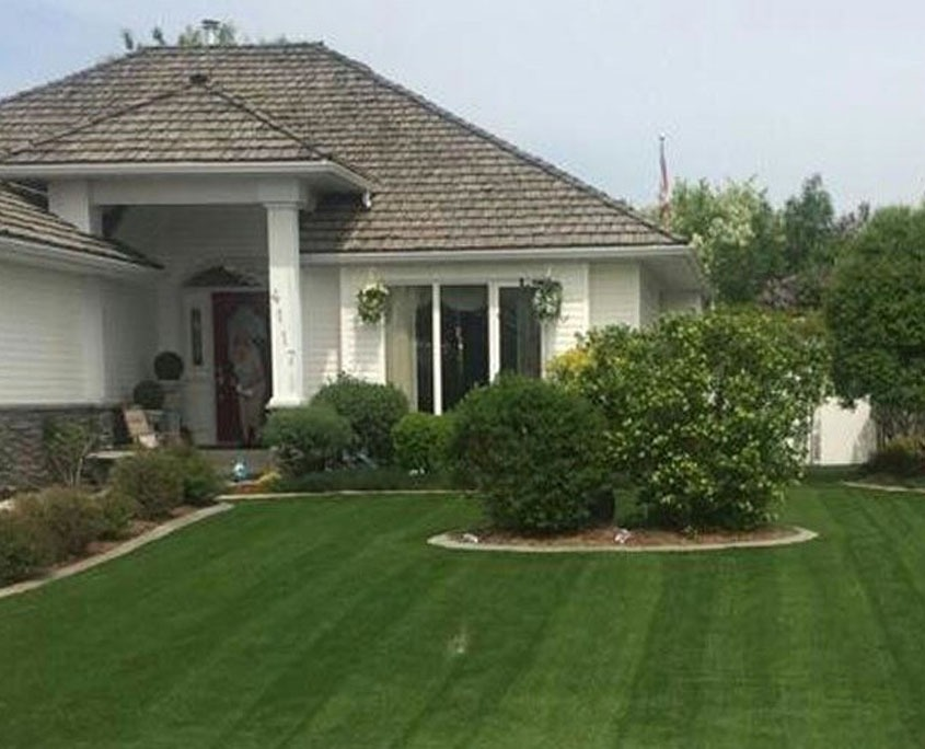 front yard with artificial turf grass
