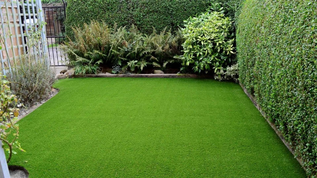 artificial grass in tulsa with bushes