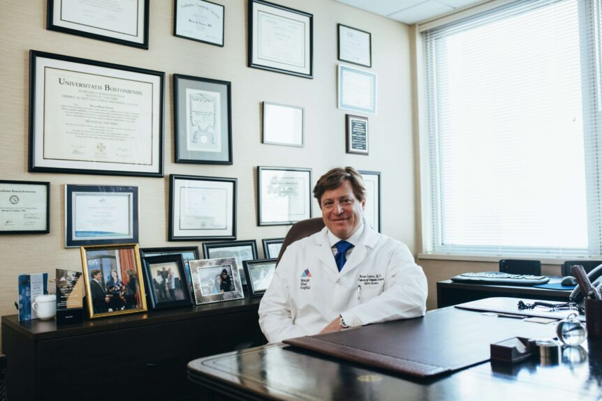 physician life coach at his desk