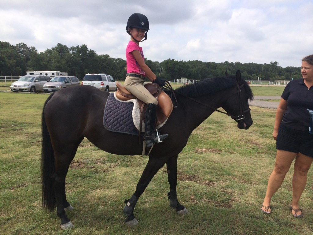 Girl on brown horse at bel Canto Farms