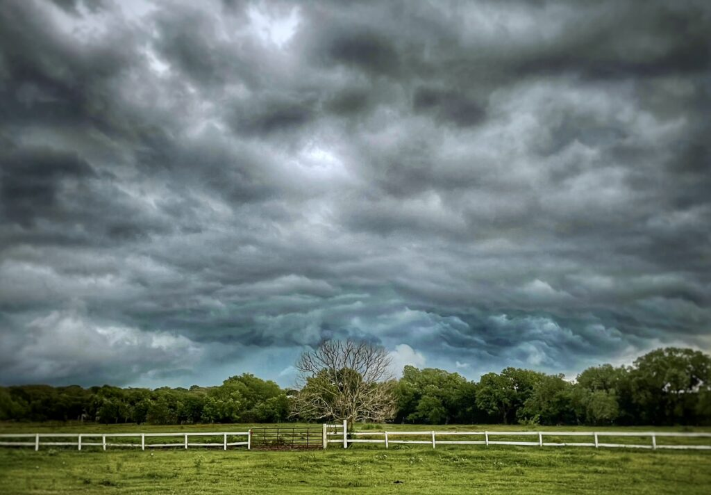 Bel canto farms horse pasture with stormy sky