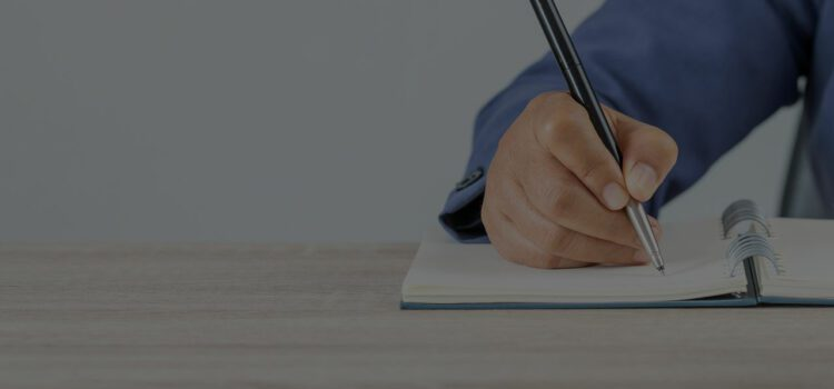 man writing in notebook blog 39