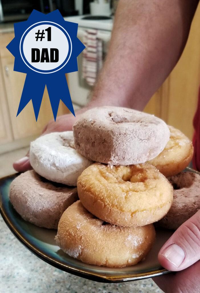Man holding plate of donuts #Entenmanns #EntenMANofTheYear